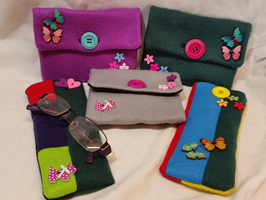 Felt purses and glass cases